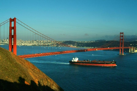 Cargo freighter passing under the Golden Gate bridge in San Fransisco. Image courtesy of FreeFoto.com